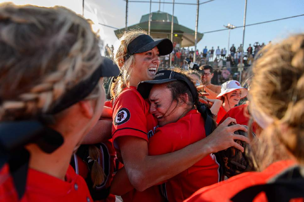 Trent Nelson     The Salt Lake Tribune Spanish Fork's Cambrie Hazel, left, is embraced by teammate Gabby Beckstrom as Spanish Fork defeats Uintah High School in the Class 4A softball state title game in Taylorsville, Thursday May 25, 2017.