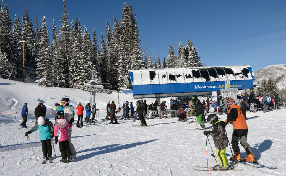 File photo | Al Hartmann  |  The Salt Lake Tribune Skiers gather at the bottom of Moonbeam lift at Solitude Mountain Resort, Utah, on Monday Dec. 26, 2016. With heavy snowfall, the state's 14 resorts attracted 4,584,658 skier days in the 2016-17 season. That eclipsed the previous record (4,457,575 skier days), which stood for only a year, by 2.9 percent. A skier day is counted each time a person buys a daily lift ticket or uses a season's pass.