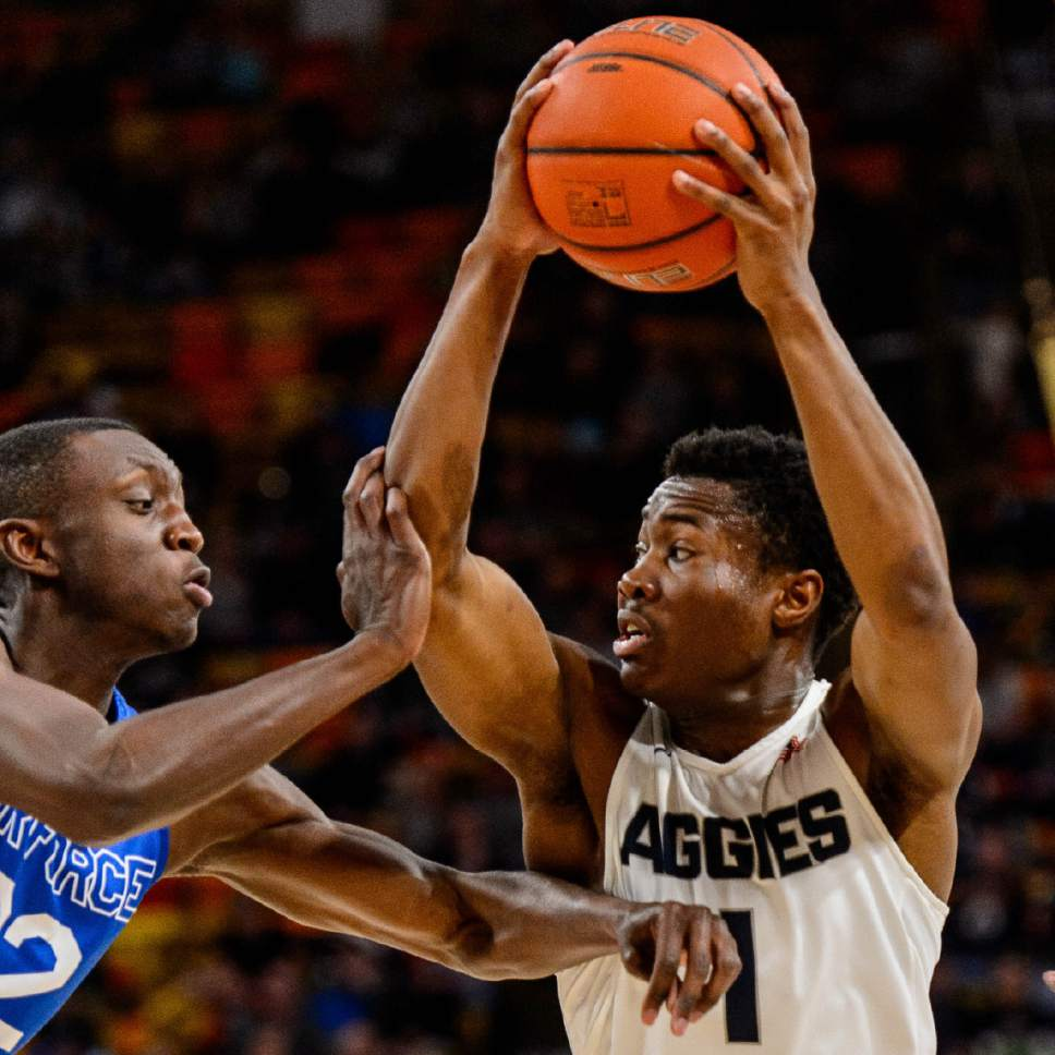 Trent Nelson  |  The Salt Lake Tribune Utah State Aggies guard Koby McEwen (1) drives on Air Force Falcons guard Pervis Louder (22) as Utah State hosts Air Force, NCAA basketball in Logan, Saturday February 25, 2017.
