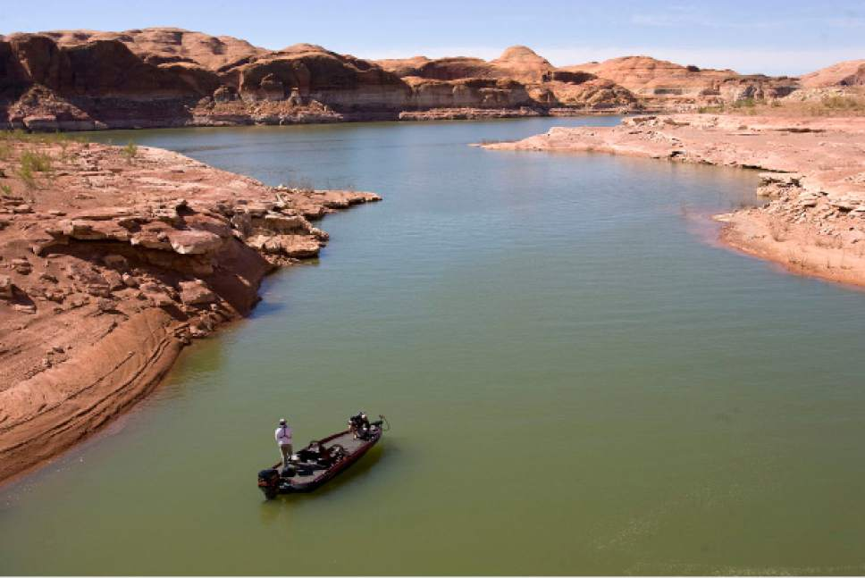 "File photo | Al Hartmann  |  The Salt Lake Tribune Fishermen relax at Good Hope Bay at Lake Powell. Utah's congressional delegation hopes President Donald Trump's interest in infrastructure will help make the controversial Lake Powell Pipeline, which would run from the lake to Washington County, a reality a little sooner. Members have asked the president to make the pipeline a ""high priority"" and to expedite the project's environmental reviews and approvals ­-- making the request before the state has finished its application to the Federal Energy Regulatory Commission to build it."