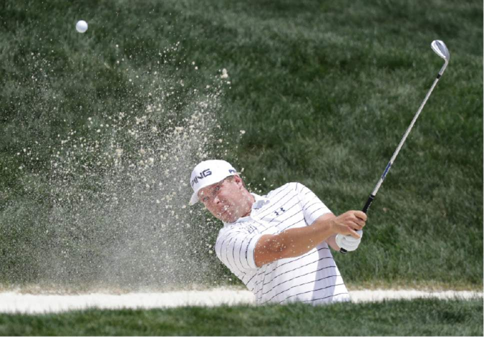 Daniel Summerhays hits out of a bunker on the fourth hole during the final round of the Memorial golf tournament, Sunday, June 4, 2017, in Dublin, Ohio. (AP Photo/Darron Cummings)