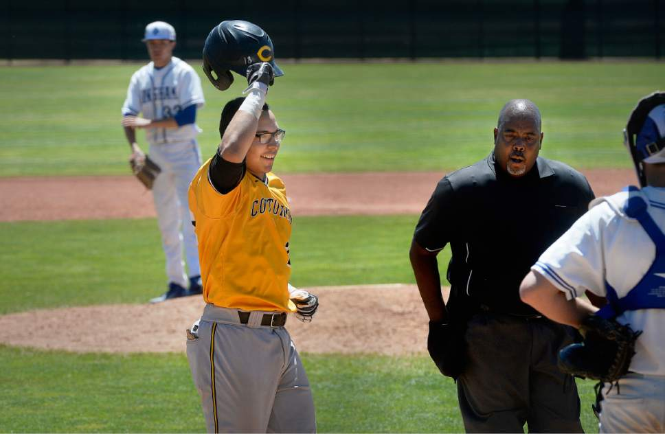 Scott Sommerdorf  |  Tribune file photo Cottonwood catcher Christopher Rowan doffed his batting helmet as he came to the plate after his sixth-inning HR had tied the score at 1-1 against Bingham in their 5A state semifinal last month.