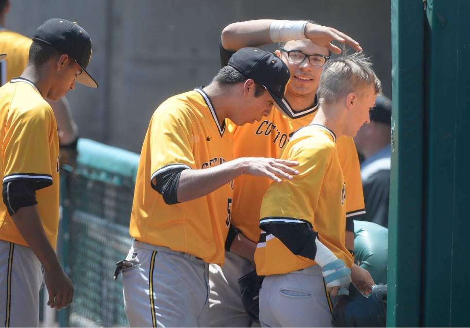 Scott Sommerdorf | The Salt Lake Tribune Cottonwood catcher Christopher Rowan pats Cade Perkins on the head after he came in to score what turned out to be the winning run as Cottonwood beat Bingham 2-1 in a 5A baseball state semifinal, Wednesday, May 24, 2017.