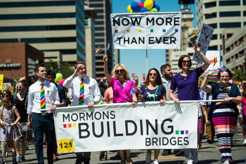 Chris Detrick  |  Tribune file photo Members of Mormons Building Bridges participate during the Utah Pride Parade last year.