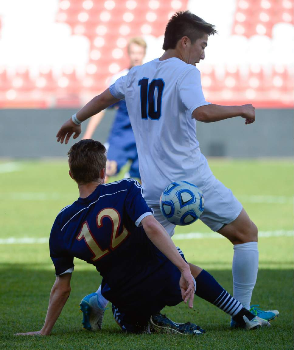 Francisco Kjolseth | The Salt Lake Tribune Herriman's Ethan Alexander (12) gets tangled up with Kaden Amano (10) of Layton during the 5A boys' state soccer championship  at Rio Tinto Stadium, Thursday, May 25, 2017.