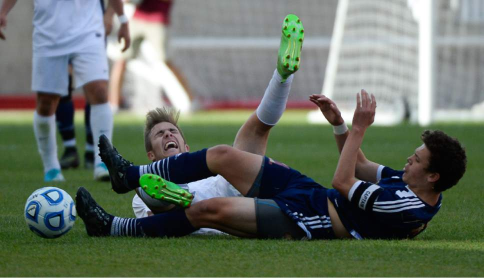 Francisco Kjolseth | The Salt Lake Tribune Layton's Easton Embley collides with Herriman's Carter Johnson during the 5A boys' state soccer championship  at Rio Tinto Stadium, Thursday, May 25, 2017. Layton went on to win in shootout 5-3.