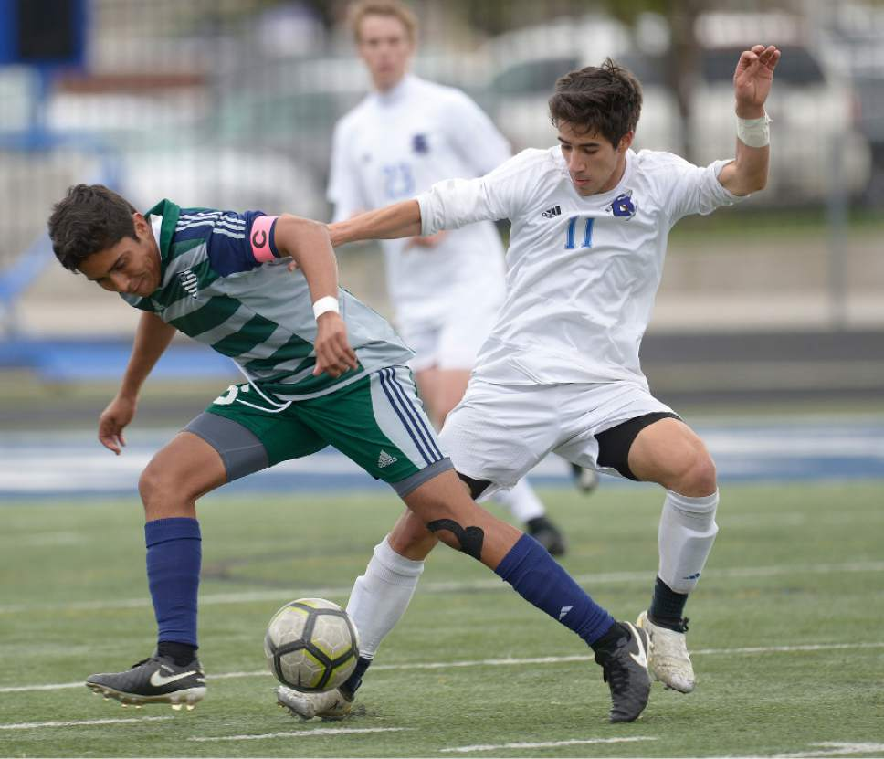 Leah Hogsten  |  The Salt Lake Tribune  Copper Hills' Carlos Becerra-Gomez and Bingham's Tommy Merniez battle for possession. Bingham High School boys' soccer team defeated Copper Hills High School 2-1, during their game April 25, 2017.