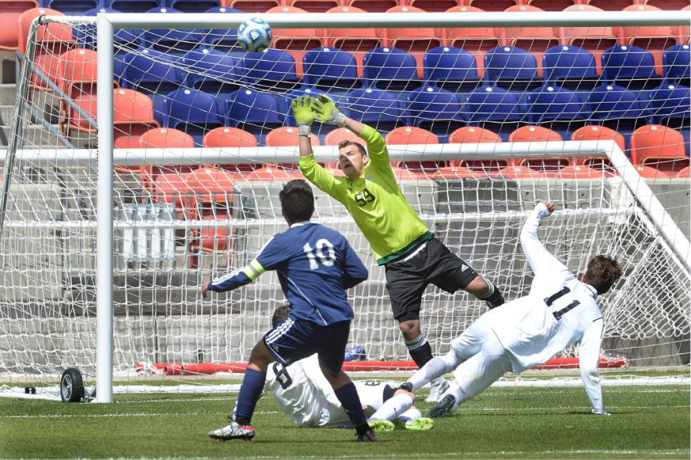 Scott Sommerdorf | The Salt Lake Tribune Juan Diego's Ruben Castillo missed his second goal of the game by inches as he put this shot just above the crossbar. Ridgeline beat Juan Diego 2-1 in 2 OT to win the 3A state soccer championship, Saturday, May 13, 2017.