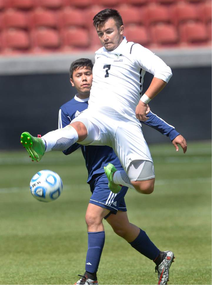 Scott Sommerdorf | The Salt Lake Tribune Alex Cruz of Ridgeline goes up to get a ball in front of Ruben Castillo of Juan Diego during second half play. Ridgeline beat Juan Diego 2-1 in 2 OT to win the 3A state soccer championship, Saturday, May 13, 2017.