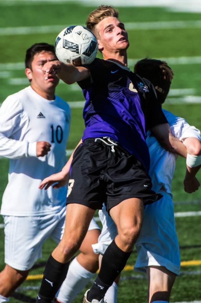 Chris Detrick  |  The Salt Lake Tribune Desert Hills' Walker Heaton (8) Juan Diego's Ruben Castillo (10) and Juan Diego's Seth Blasingim (14) go for the ball during the game at Juan Diego High School Thursday, May 4, 2017.