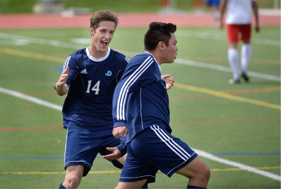 Scott Sommerdorf | The Salt Lake Tribune Juan Diego's Seth Blasingim, left, helps Ruben Castillo, celebrate his first of three goals that beat Park City goalkeeper Andrew Guthery as Juan Diego beat Park City 4-0 in a 3A boys' soccer state quarterfinal played in Park City, Saturday, May 6, 2017.