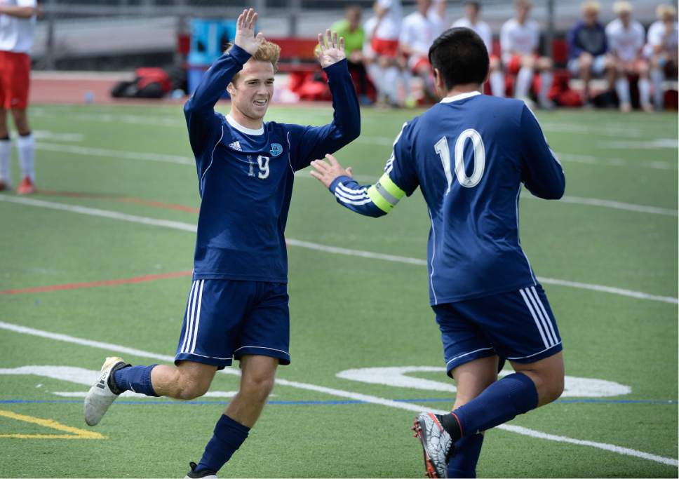 Scott Sommerdorf | The Salt Lake Tribune Juan Diego's Jared Mariani, left, helps Ruben Castillo celebrate his first of three goals that got past Park City goalkeeper Andrew Guthery as Juan Diego beat Park City 4-0 in a 3A boys' soccer state quarterfinal played in Park City, Saturday, May 6, 2017.