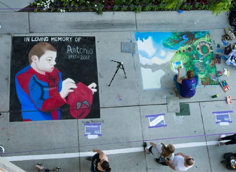 Rick Egan  |  The Salt Lake Tribune  A chalk art on Rio Grande Street at the Gateway, during the Utah Foster Care Chalk Art Festival, Saturday, June 17, 2017.
