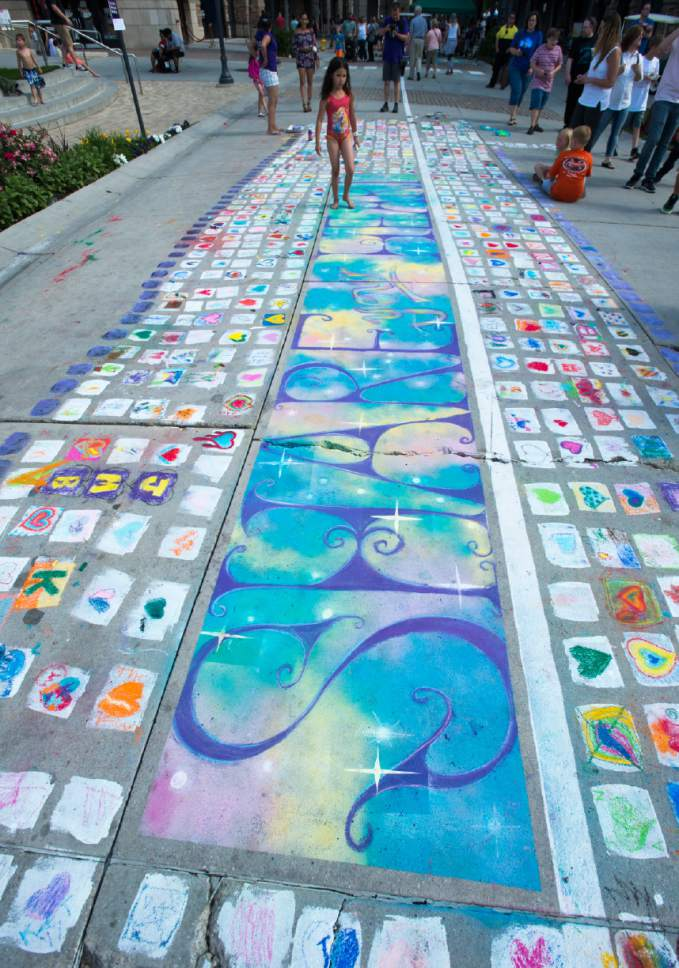 Rick Egan  |  The Salt Lake Tribune  The chalk art on Rio Grande Street at the Gateway, during the Utah Foster Care Chalk Art Festival, Saturday, June 17, 2017.