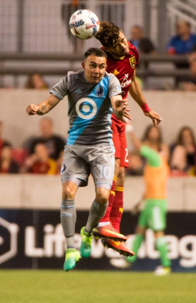 Rick Egan     The Salt Lake Tribune  Real Salt Lake midfielder Danilo Acosta (25) and Minnesota United midfielder Miguel Ibarra (10) go for the ball, in MLS action at Rio Tinto Stadium, Saturday, June 17, 2017.