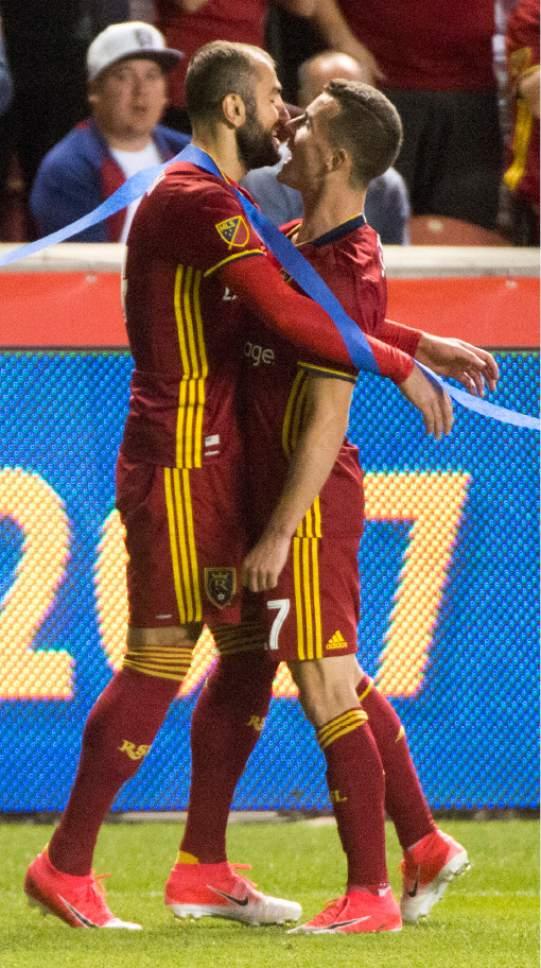 Rick Egan     The Salt Lake Tribune  Real Salt Lake forward Brooks Lennon (27) congratulates  the goal by Real Salt Lake forward Yura Movsisyan (14), in MLS soccer action at Rio Tinto Stadium, Saturday, June 17, 2017.