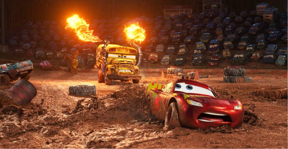 "This image released by Disney shows Lightning McQueen, voiced by Owen Wilson, foreground, in a scene from ""Cars 3."" (Disney-Pixar via AP)"