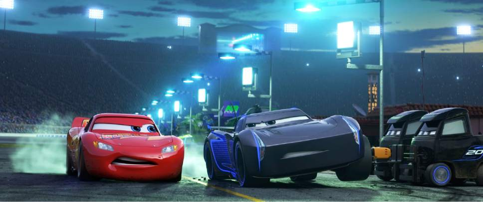 "This image released by Disney shows Lightning McQueen, voiced by Owen Wilson, left, and Armie Hammer voiced by Jackson Storm in a scene from ""Cars 3."" (Disney-Pixar via AP)"