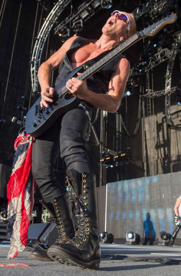 Rick Egan  |  The Salt Lake Tribune  Phil Collen plays guitar for Def Leppard as they play USANA Amphitheatre, Monday, June 23, 2014