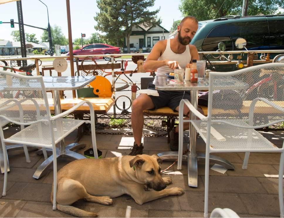 Rick Egan | The Salt Lake Tribune Nate Zubal Eats On The Patio At The Pig