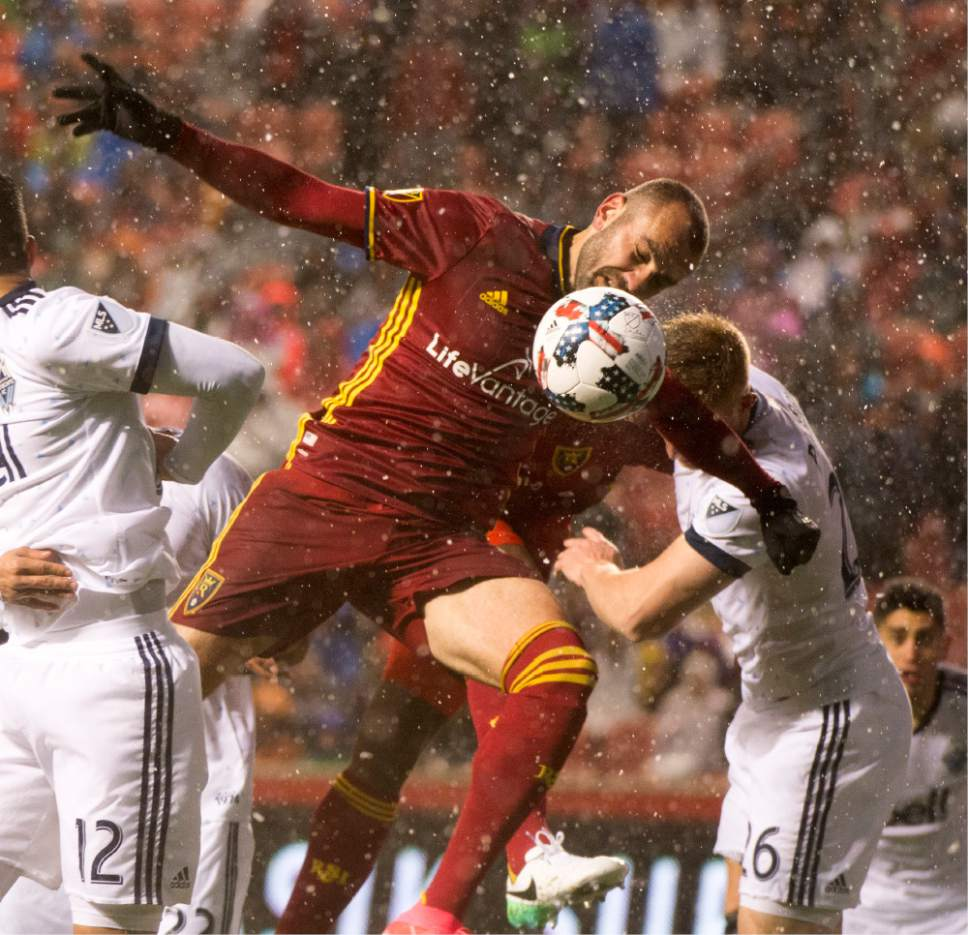 Rick Egan  |  The Salt Lake Tribune  Real Salt Lake forward Yura Movsisyan (14) battles Vancouver Whitecaps defender Tim Parker (26) for the ball, in RSL action at Rio Tinto Stadium, Saturday, April 8, 2017.