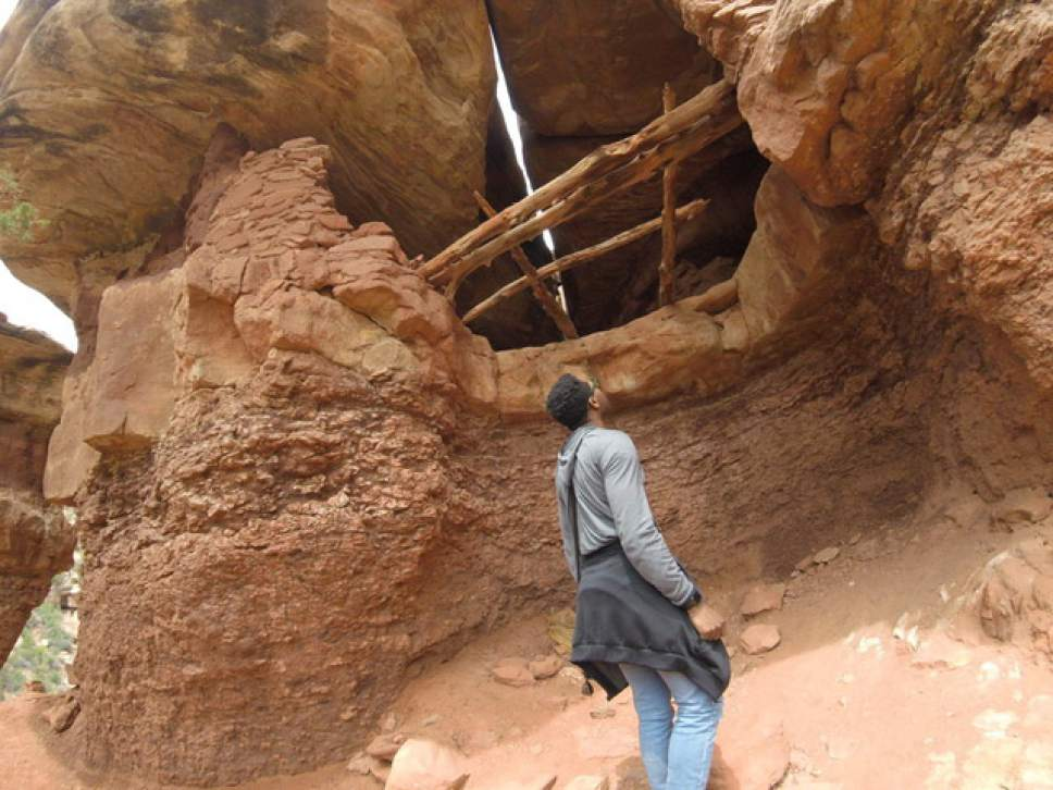 |  Courtesy of Justin Bass  Repertory Dance Theatre dancer Justin Bass explores Moon House Ruin in Bears Ears National Monument.