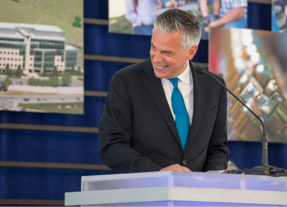Leah Hogsten  |  The Salt Lake Tribune Former Utah Gov. Jon M. Huntsman shares a laugh with his parents Jon M. Huntsman Sr. and Karen Huntsman during the dedication ceremony of the Primary Children's and Families' Cancer Research Center, June 21, 2017.