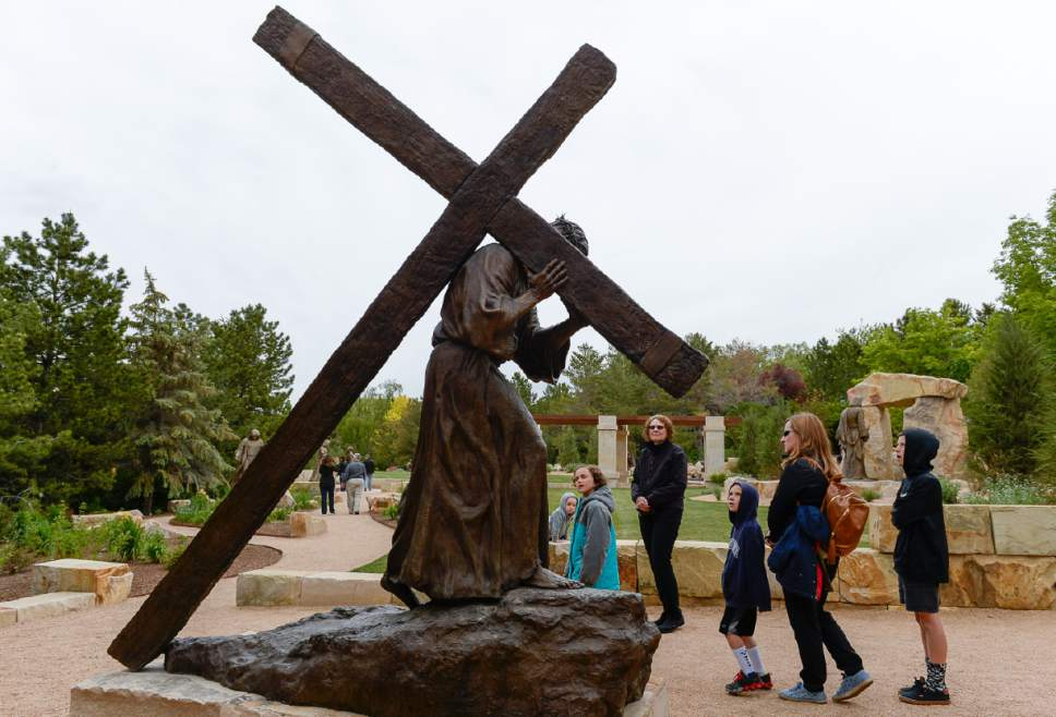 """Francisco Kjolseth     The Salt Lake Tribune Artist Angela Johnson captured Christ's agony in carrying a heavy, rugged cross to Golgotha in this scene, one of 15 including 35 figures at the """"Light of the World"""" exhibit, at the heart of Thanksgiving Point's Ashton Gardens in Lehi."""