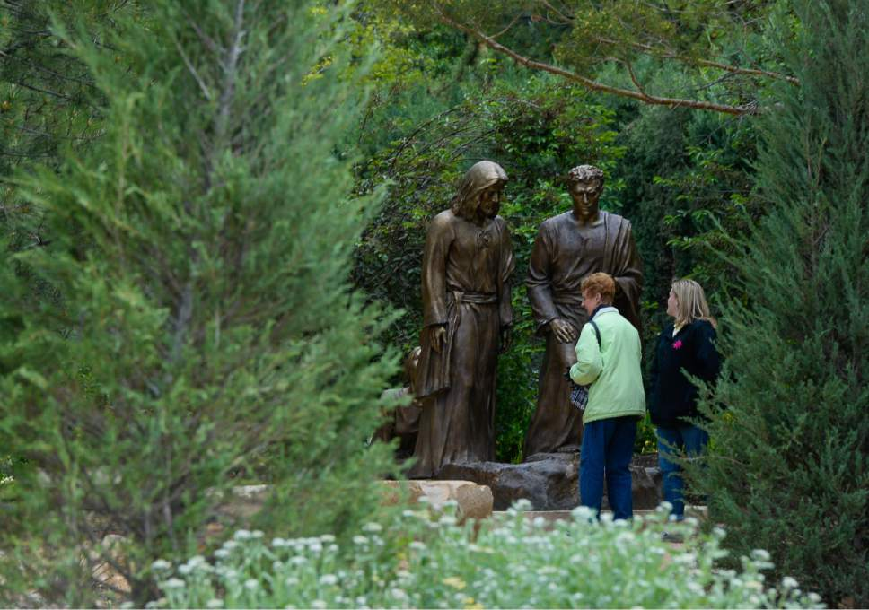 """Francisco Kjolseth     The Salt Lake Tribune Artist Angela Johnson, whose ongoing sculpting of larger-than-life works at the """"Light of the World"""" exhibit, is at the heart of Thanksgiving Point's Ashton Gardens in Lehi. Conveying passion, humanity and miracles from the life of Jesus Christ, 15 scenes with 35 sculptures adorn the new centralized permanent exhibit at the gardens."""