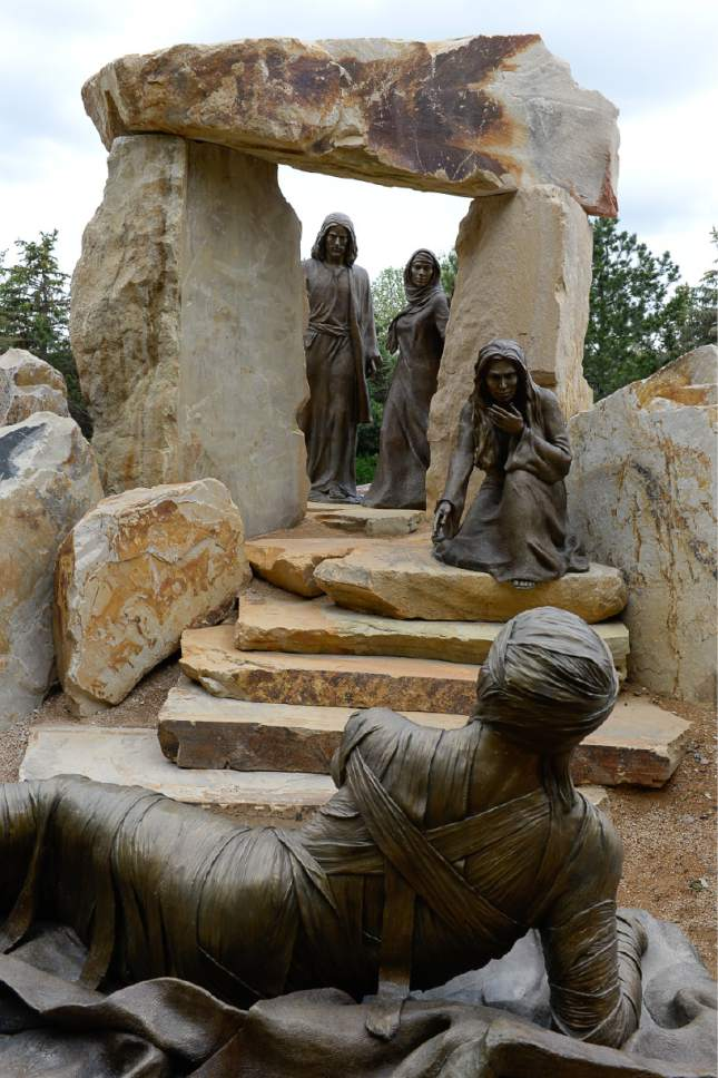 """Francisco Kjolseth     The Salt Lake Tribune Artist Angela Johnson captures the perspective of Lazarus, moments after being raised from the dead by Christ. It is one of 15 scenes and 35 figures she sculpted for the permanent """"Light of the World"""" exhibit, at the heart of Thanksgiving Point's Ashton Gardens in Lehi."""
