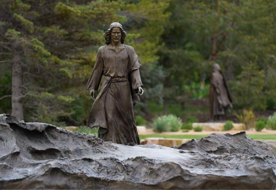 """Francisco Kjolseth     The Salt Lake Tribune Artist Angela Johnson captures Christ's walk on storm-tossed waves of the Sea of Galilee, a work she says has special, personal meaning to her. It is one of 15 scenes and 35 figures she sculpted for the permanent """"Light of the World"""" exhibit, at the heart of Thanksgiving Point's Ashton Gardens in Lehi."""