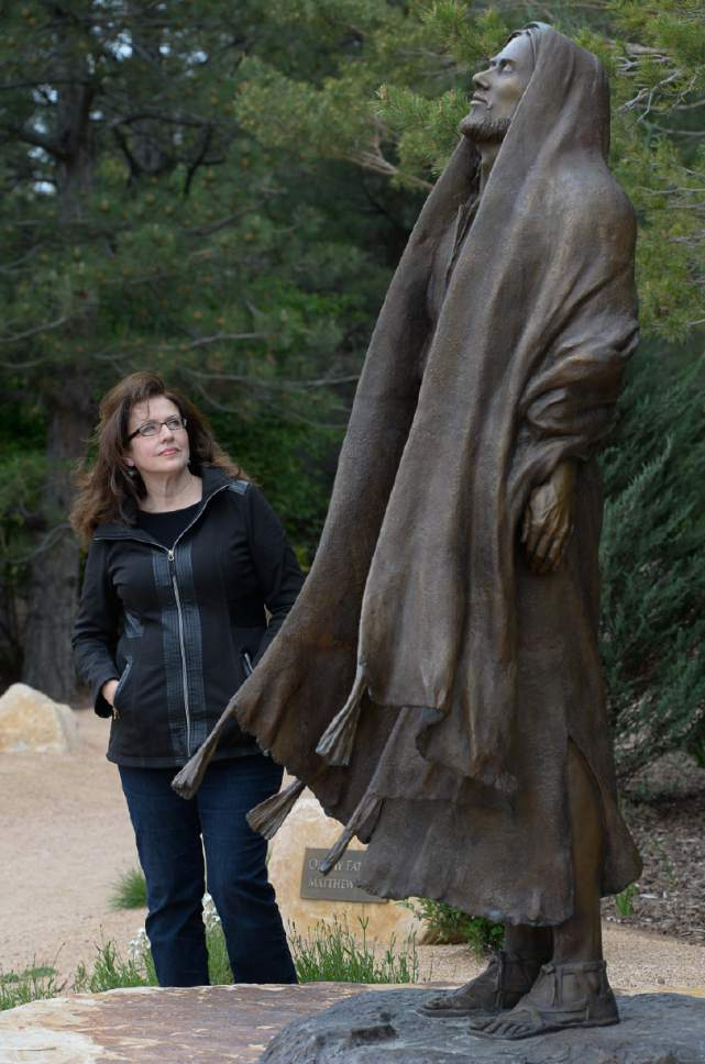 """Francisco Kjolseth     The Salt Lake Tribune Artist Angela Johnson talks about her work at the """"Light of the World"""" exhibit, in the heart of Thanksgiving Point's Ashton Gardens in Lehi. Conveying passion, humanity and miracles from the life of Jesus Christ, 15 scenes with 35 sculptures adorn the new centralized permanent exhibit at the gardens."""