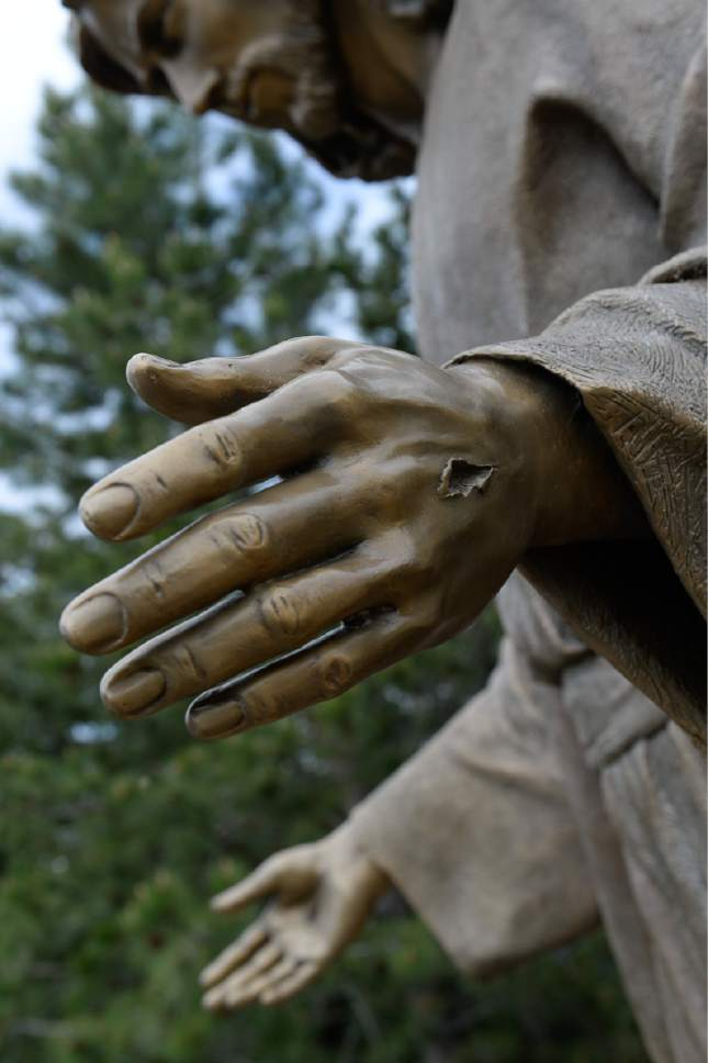 """Francisco Kjolseth     The Salt Lake Tribune Artist Angela Johnson, whose ongoing sculpting of larger-than-life works at the """"Light of the World"""" exhibit, is at the heart of Thanksgiving Point's Ashton Gardens in Lehi. This scene shows her attention to detail, even down to the torn flesh from crucifixion nails."""