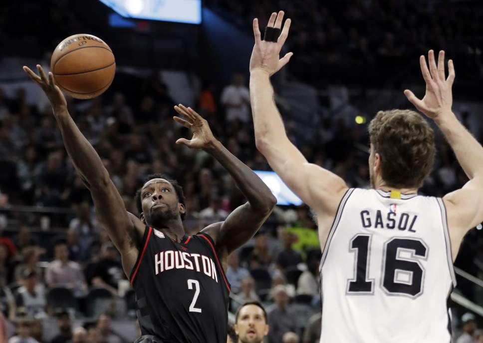 Houston Rockets' Patrick Beverley (2) goes up for a shot as San Antonio Spurs' Pau Gasol (16) of Spain defends during the first half of Game 5 in a second-round NBA basketball playoff series, Tuesday, May 9, 2017, in San Antonio. (AP Photo/Eric Gay)
