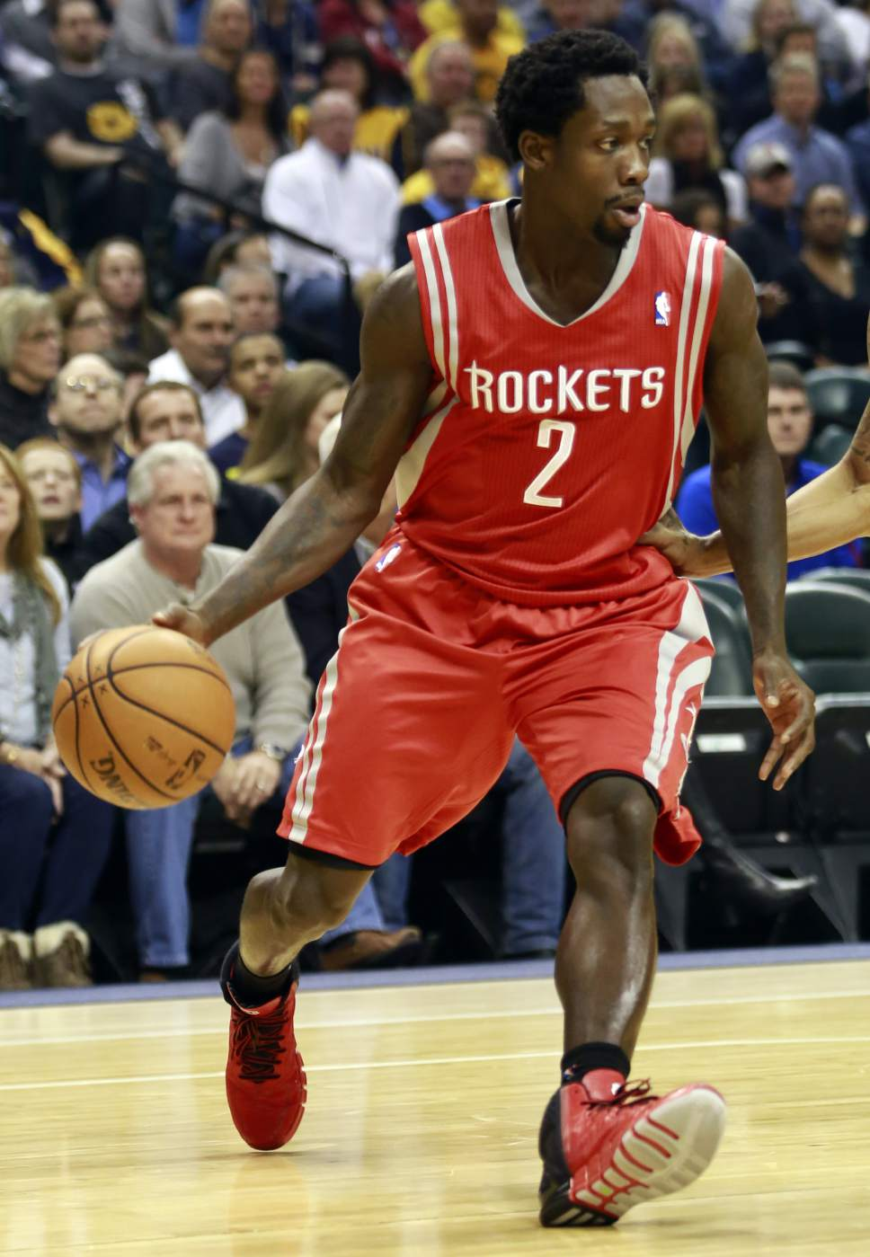 Houston Rockets guard Patrick Beverley dribbles the basketball against the Indiana Pacers in the first half of an NBA basketball game in Indianapolis, Friday, Dec. 20, 2013. (AP Photo/R Brent Smith)
