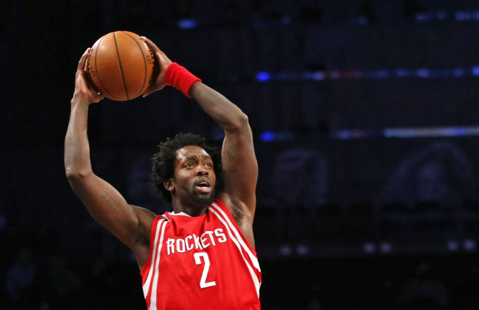 Houston Rockets guard Patrick Beverley (2) looks to pass in the first half of an NBA basketball game, Tuesday, Dec. 8, 2015, in New York. (AP Photo/Kathy Willens)