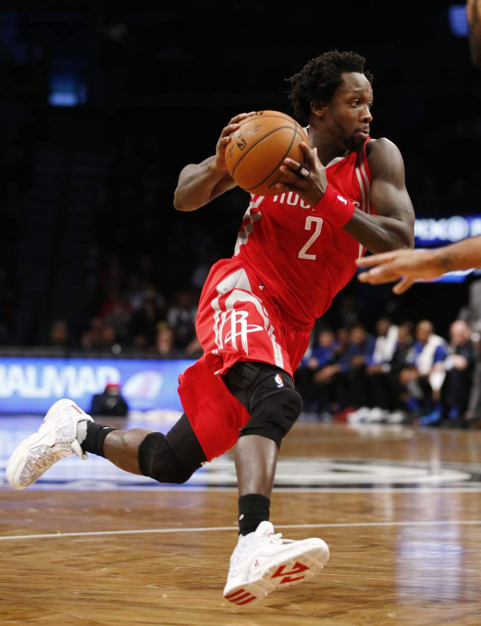 Houston Rockets guard Patrick Beverley (2) drives down court in the first half of an NBA basketball game, Tuesday, Dec. 8, 2015, in New York. (AP Photo/Kathy Willens)