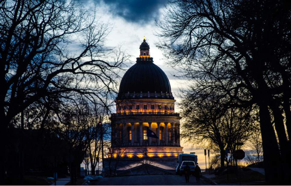 Steve Griffin     The Salt Lake Tribune   Lights on the Utah State Capitol glow as the sun sets  Tuesday February 7, 2017