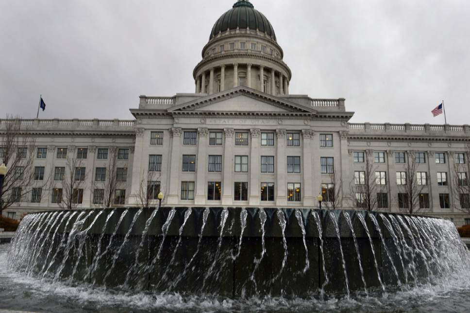 Scott Sommerdorf      The Salt Lake Tribune An approaching storm blows the waters in the Capitol fountain sideways, Wednesday, Feb. 19, 2014.