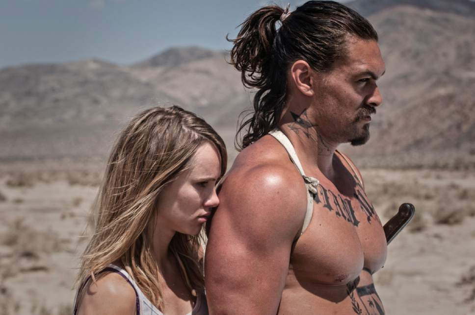 """Arlen (Suki Waterhouse, left) and Miami Man (Jason Momoa) prepare for a fight, in a scene from the dystopian horror-thriller """"The Bad Batch."""" Courtesy Neon Films"""
