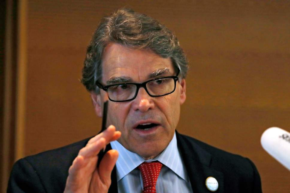 """FILE - In this June 6, 2017, file photo, U.S. Energy Secretary Rick Perry speaks during the carbon capture, utilization and storage event, on the sidelines of the clean energy conference held at the China National Convention Center in Beijing. Republicans and Democrats are denouncing President Donald Trump's proposed energy budget, and even Perry is distancing himself from the plan.  As senators condemned the budget at a hearing June 22, Perry made it clear he did not have a say on the request submitted to Congress. Perry told the Senate energy panel that the $28 billon proposal """"was written before I got here,'' adding: """"My job is to defend it.''  (AP Photo/Andy Wong, File)"""