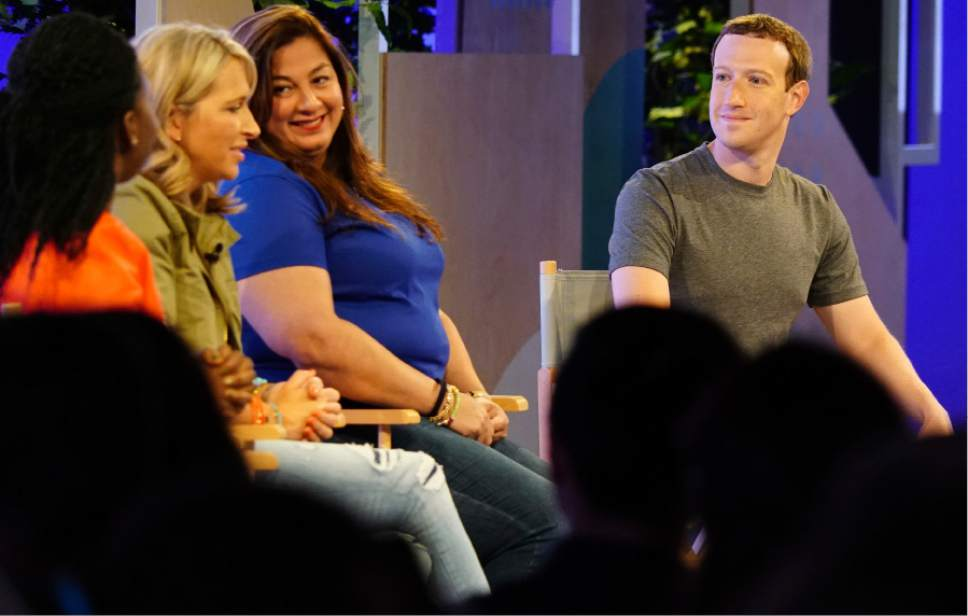 Facebook CEO Mark Zuckerberg, right, speaks with panelists at the Facebook Communities Summit, Thursday, June 22, 2017, in Chicago. Zuckerberg announced a new Facebook initiative designed to spur people to form more meaningful communities with Facebook's groups feature. From left are Lola Omolola, Erin Schatteman and Janet Sanchez, who run popular Facebook groups. (AP Photo/Teresa Crawford)