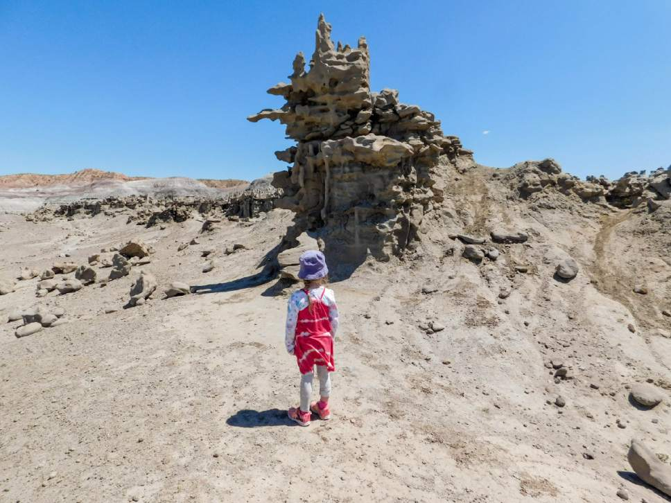 Erin Alberty  |  The Salt Lake Tribune   A young hiker examines a rock formation in Fantasy Canyon, south of Vernal. Photo taken May 28, 2017.
