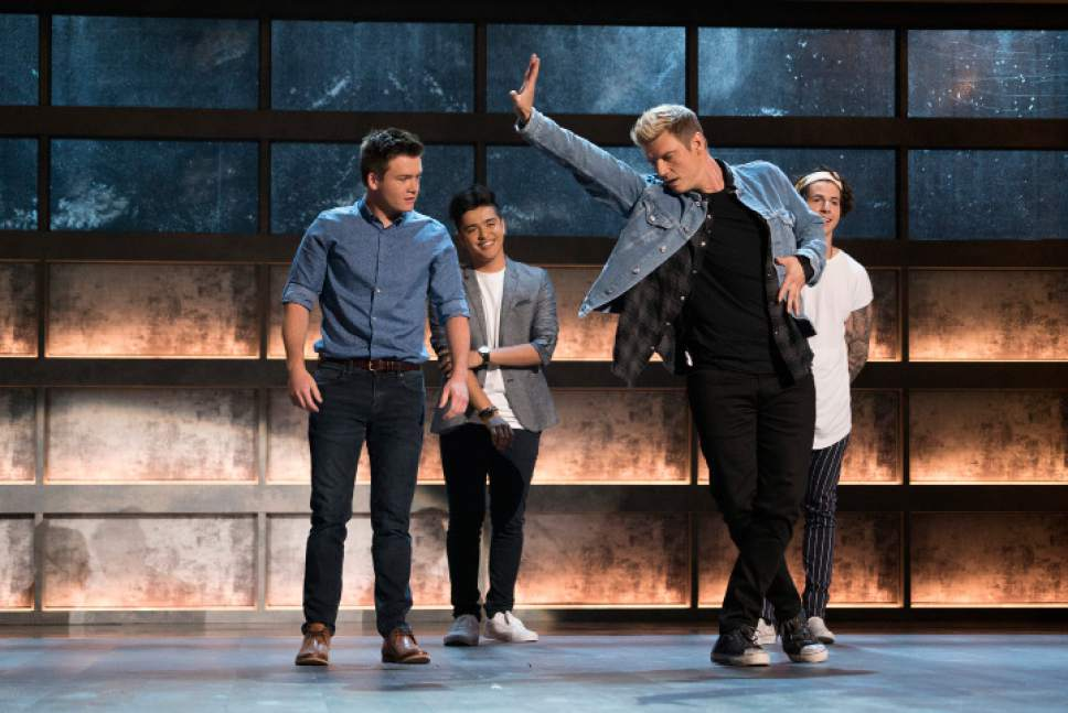 "Eric McCandless  |  ABC   Nick Carter (foreground) works with three contestants on ABC's ""Boy Band."""
