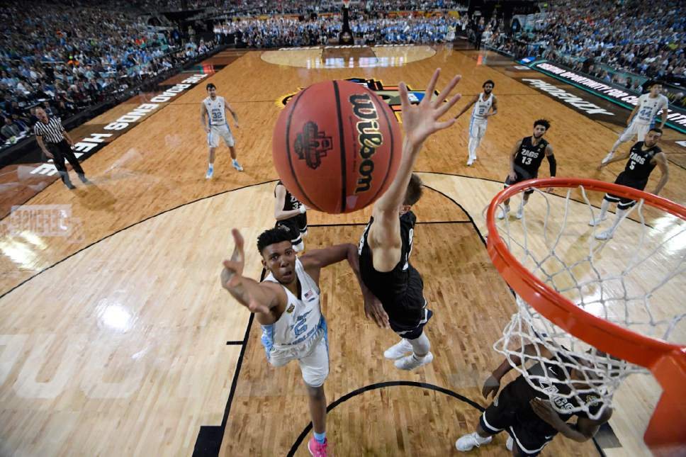 North Carolina's Tony Bradley (5) takes a shot during the first half in the finals of the Final Four NCAA college basketball tournament against Gonzaga, Monday, April 3, 2017, in Glendale, Ariz. (AP Photo/Chris Steppig, Pool)