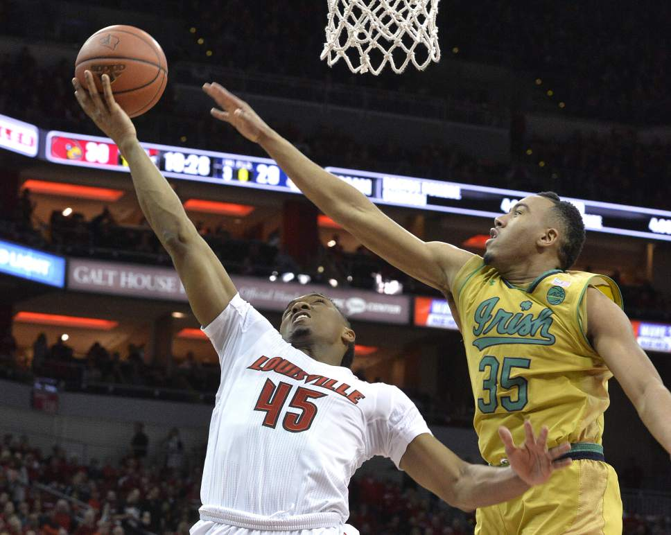 Louisville's Donovan Mitchell (45) goes up for a shot ahead of Notre Dame's Bonzie Colson (35) during the second half of an NCAA college basketball game, Saturday, March 4, 2017, in Louisville, Ky. Louisville won 71-64. (AP Photo/Timothy D. Easley)