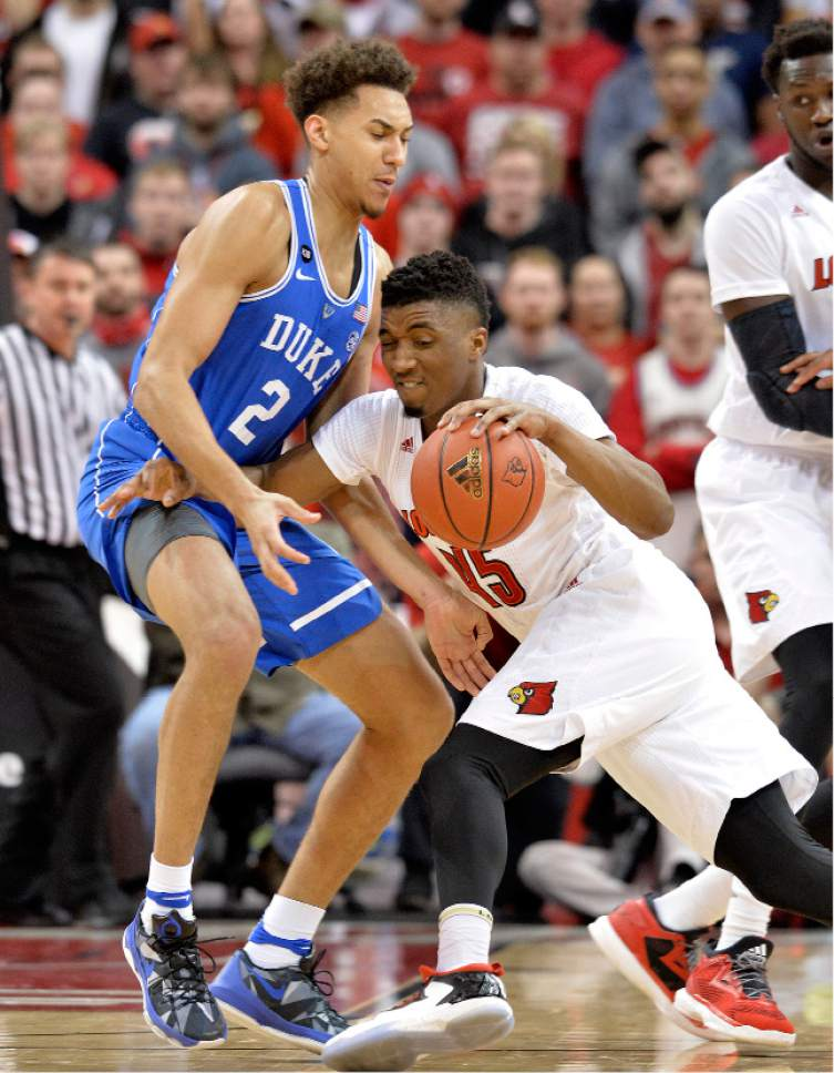 Louisville's Donovan Mitchell (45) attempts to get past the defense of Duke's Chase Jeter (2) during the first half of an NCAA college basketball game, Saturday, Jan. 14, 2017, in Louisville, Ky. (AP Photo/Timothy D. Easley)