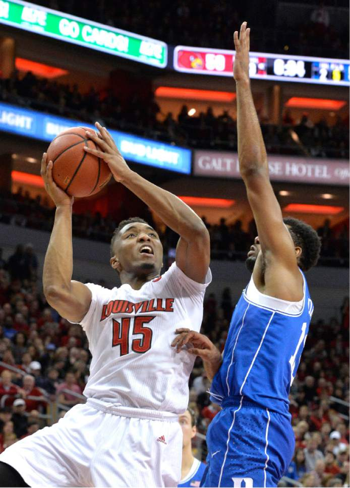 Louisville's Donovan Mitchell (45) shoots over Duke's Matt Jones (13) during the second half of an NCAA college basketball game, Saturday, Jan. 14, 2017, in Louisville, Ky. Louisville won 78-69. (AP Photo/Timothy D. Easley)