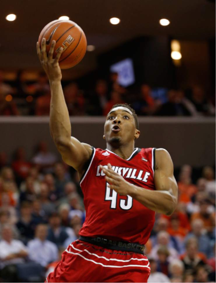 Louisville guard Donovan Mitchell (45) makes a layup during the first half of an NCAA college basketball game in Charlottesville, Va., Monday, Feb. 6, 2017. (AP Photo/Steve Helber)