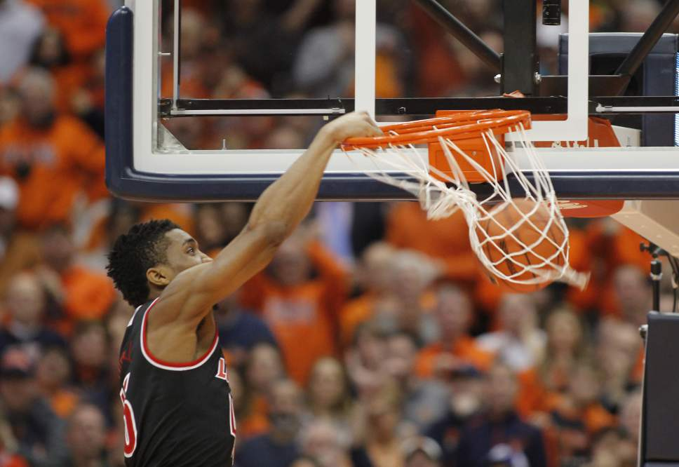 Louisville's Donovan Mitchell jams the ball in the second half of an NCAA college basketball game against Syracuse in Syracuse, N.Y., Monday, Feb. 13, 2017. Louisville won 76-72. (AP Photo/Nick Lisi)